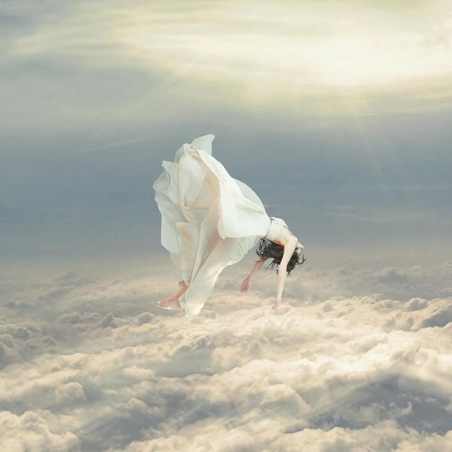 Falling woman in white dress